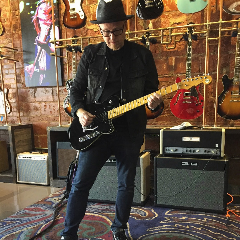 Stu G with his guitar